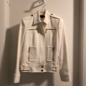 White jacket with gold tone zipper and snaps.